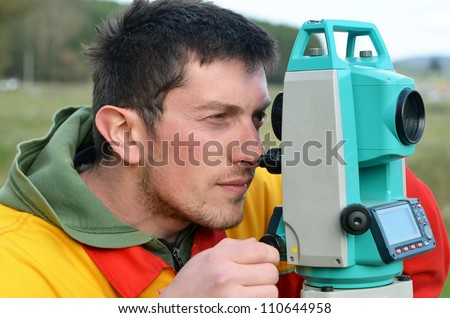 One surveyor worker working with theodolite