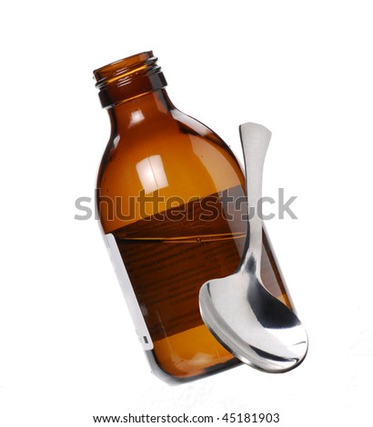 One Syrup bottle and teaspoon. - stock photo