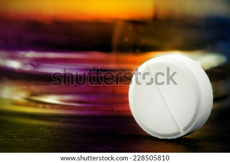 One Tablet of Acetaminophen or Paracetamol with Full Glass of Water for Relief Pain or Fever. - stock photo
