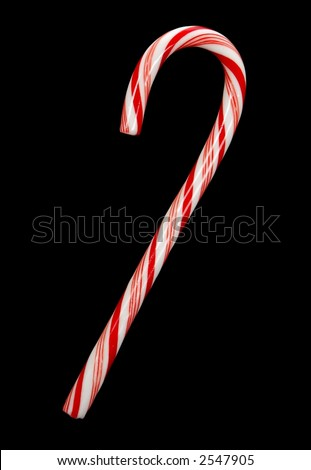 One traditional candy cane isolated on black background. - stock photo