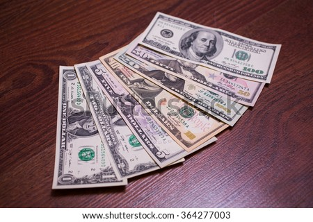 one, two, five, ten, twenty, fifty and one hundred dollar bills front side, money