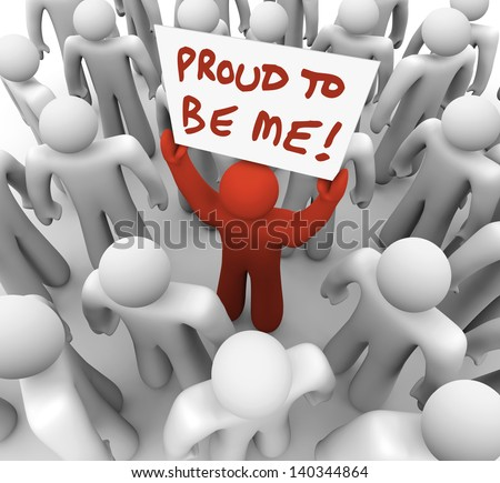 One unique or different person holds a sign in a crowd with the words Proud to Be Me to illustrate standing out in a group of people - stock photo