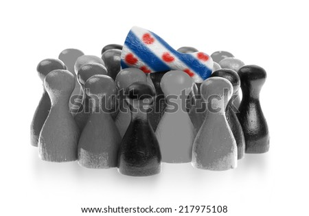 One unique pawn on top of common pawns, flag of Friesland - stock photo
