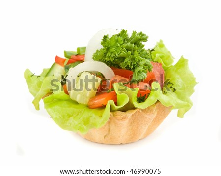 One vegetable tartlet isolated over white background.