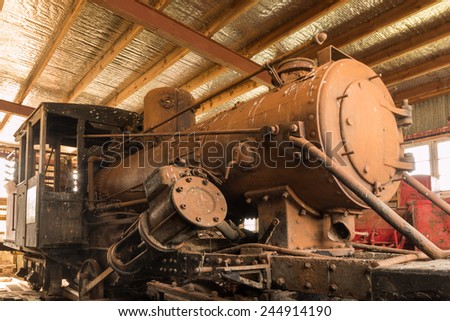 One very old and rusty steam train engine
