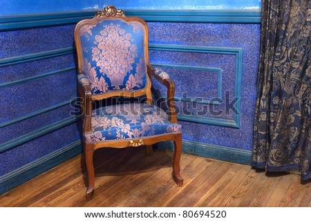 one vintage chair on wooden floor