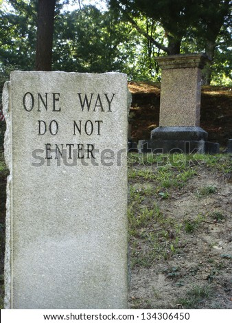 One way do not enter cemetery sign - stock photo
