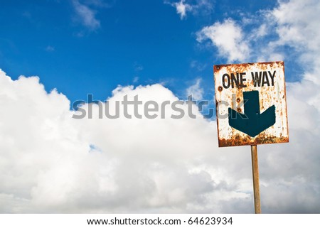 one way road sign on cloud blue sky