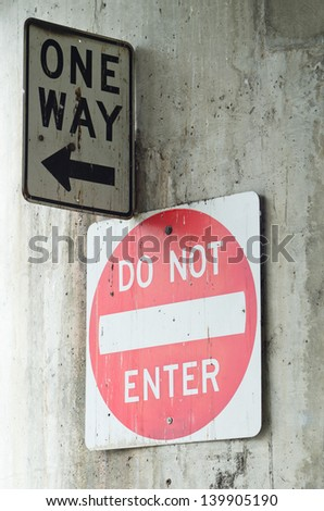 One Way Sign and Do Not Enter Sign - stock photo
