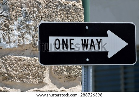 One way sign at local city street - stock photo