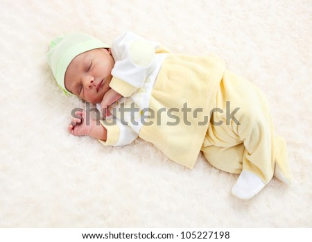 One week old baby boy asleep - stock photo