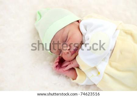 One week old baby boy asleep - stock photo