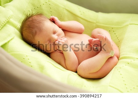 One week old newborn baby in cocoon