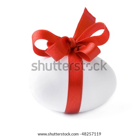 One White egg wrapped around with red ribbon bow isolated over white background