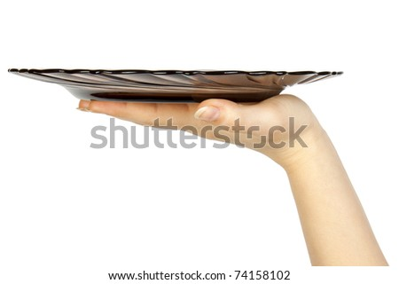 One white kitchen plate on human hand on white background - stock photo