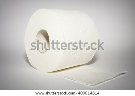 One white toilet paper on the white background with shadows