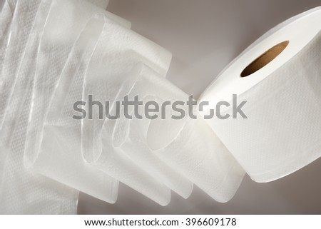 One white toilet paper roll in closeup - stock photo