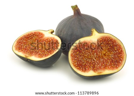 one whole and a cut fig (Ficus carica) on a white background