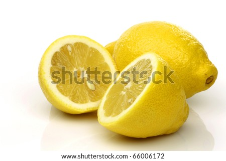 one whole and a cut lemon on a white background