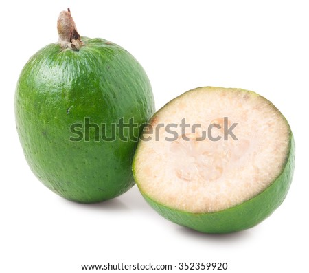 One whole and a half feijoa isolated on white background. - stock photo