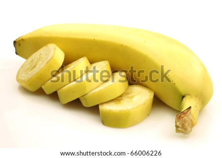 one whole banana and some pieces on a white background
