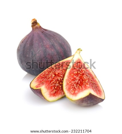 One whole fig and two quarters of figs isolated on white background - stock photo