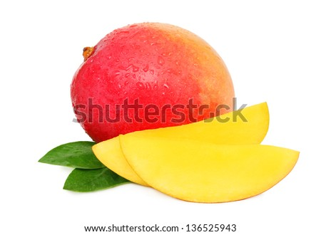 One whole mango, slices and green leaves with drops isolated on white background