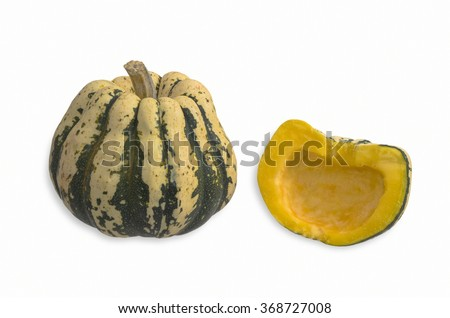 One Whole Small Sweet Dumpling Squash and One Halved Showing the Inside - stock photo
