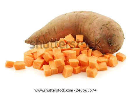 one whole sweet potato and cut blocks on a white background - stock photo
