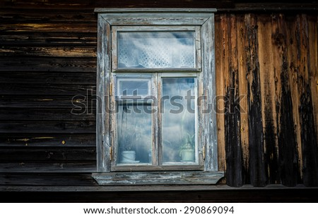 One window in the old wooden house.