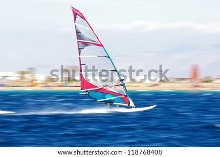 one windsurfer in Egypt, Dahab, shoot in motion, november 2012 - stock photo