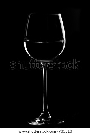 one wine glasses in backlight on the black  contrast background