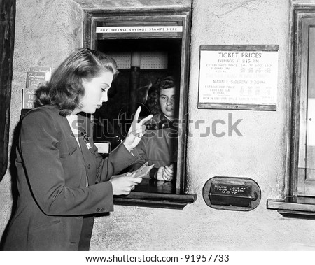 One woman buying two tickets - stock photo