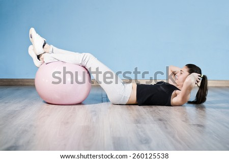 One woman doing balloon fitness abdominal exercises