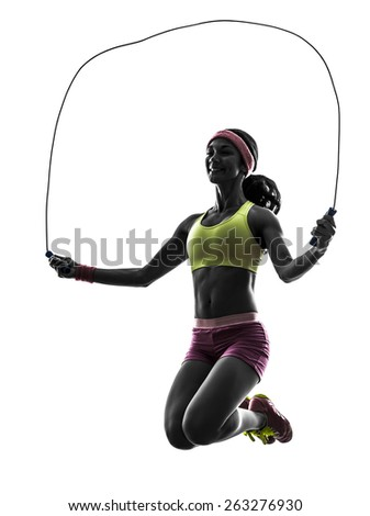 one  woman exercising fitness jumping rope in silhouette on white background - stock photo