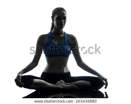 One Woman Exercising Yoga Meditating In Silhouette Studio Isolated On White Background - stock photo