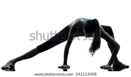 one  woman exercising yoga stretching legs warm up in silhouette studio isolated on white background - stock photo