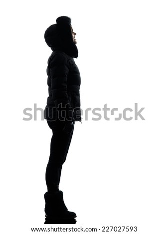 one woman in winter coat looking up smiling silhouette on white background