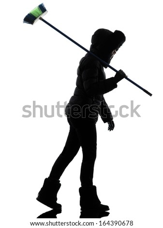 one woman in winter coat walking brooming silhouette on white background