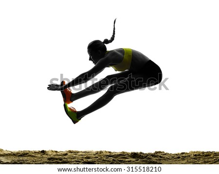 one woman praticing Long Jump silhouette in studio silhouette isolated on white background - stock photo