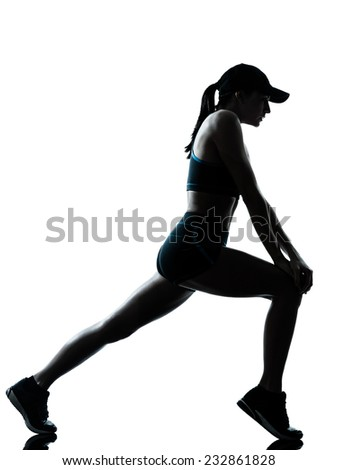 one  woman runner jogger stretching warm up in silhouette studio isolated on white background - stock photo