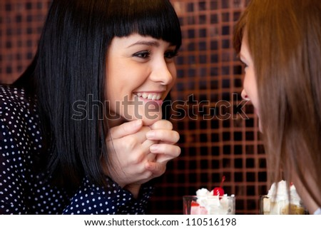 one woman talking something to friend - stock photo