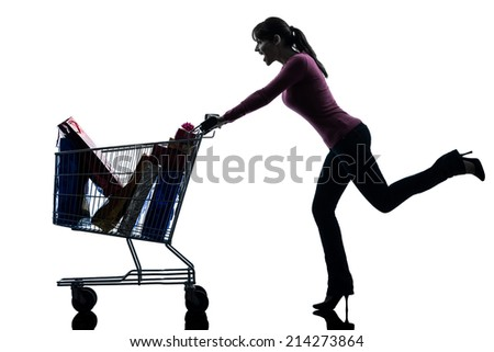 one  woman with full shopping cart in silhouette studio isolated on white background - stock photo