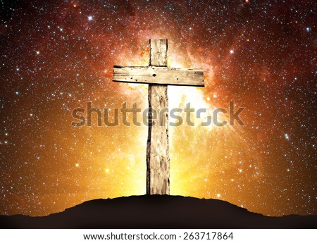 One wooden cross and background from space with stars and sunlight. Elements of this image furnished by NASA - stock photo