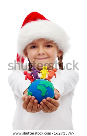 One world of happy people at christmas concept - little girl holding earth and people made of clay, isolated