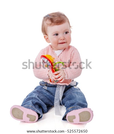 One year baby girl playing with beanbag toy isolated on white