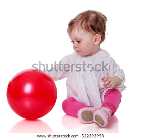 One year baby girl playing with red ball isolated on white