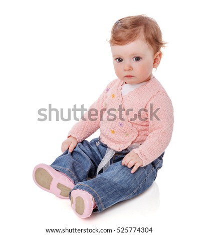 One year baby girl sitting straight waiting isolated on white