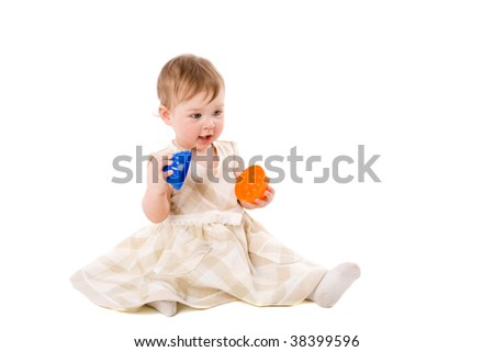 One year Baby playing with vivid toys sitting isolated
