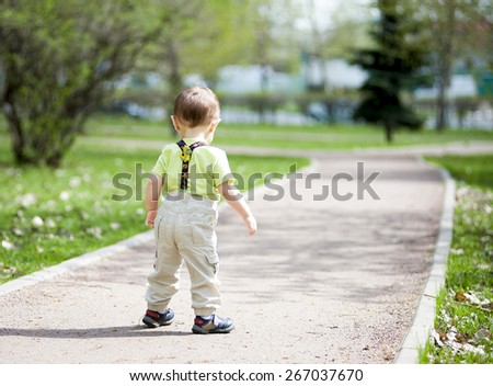 One year boy walking in the park portrait - stock photo